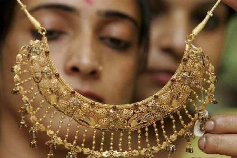 Gold hits record high, above 26,000 rupees