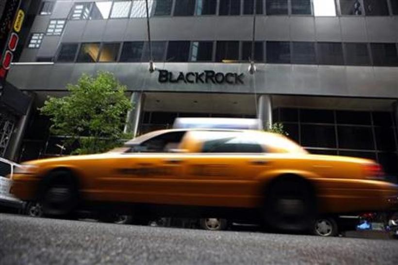 A taxi passes a BlackRock building in New York