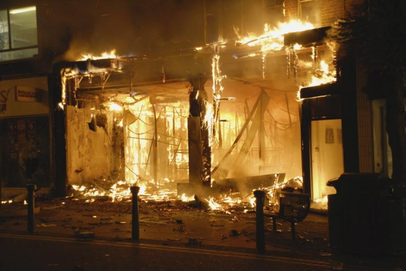 A fierce blaze guts a store after looters rampaged through a shopping mall in Woolwich, southeast London, August 9, 2011