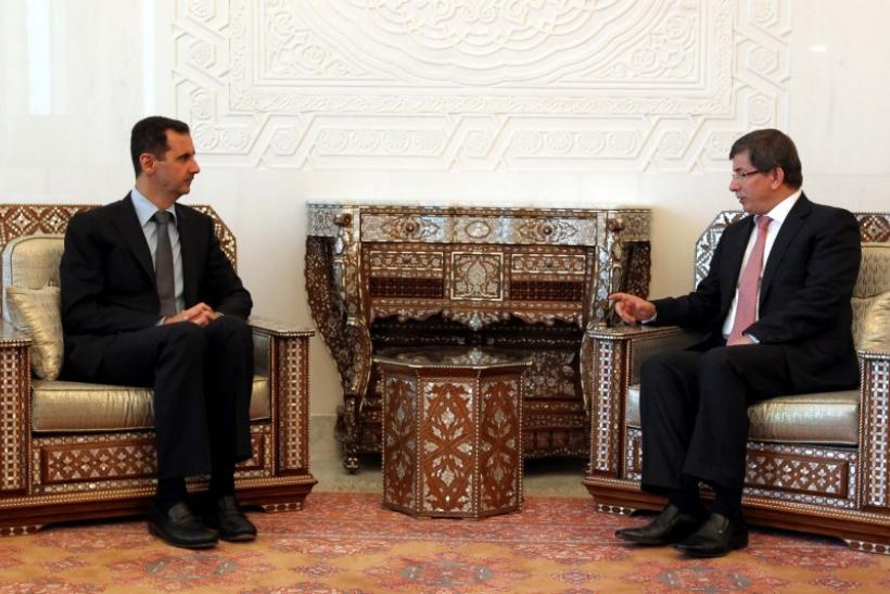 Syria's President Bashar al-Assad meets with Turkish Foreign Minister Ahmet Davutoglu in Damascus