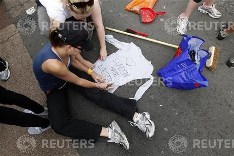 A volunteer writes on a shirt before helping to clear up in Clapham Junction, in south London