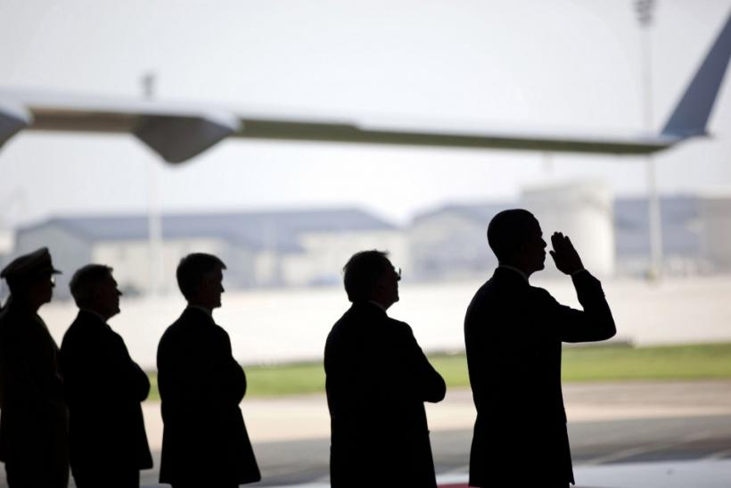 U.S. President Barack Obama salutes during a ceremony for the dignified transfer of U.S. and Afghan personnel who died in Afghanistan, at airbase in Dover, Delaware