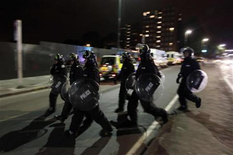 Police officers in riot gear are deployed in Eltham, south London