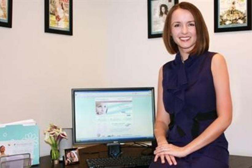 Danielle Tate, co-founder of bridal name change website MissNowMrs.com, is seen at her office in Potomac, Maryland in this undated handout photo.