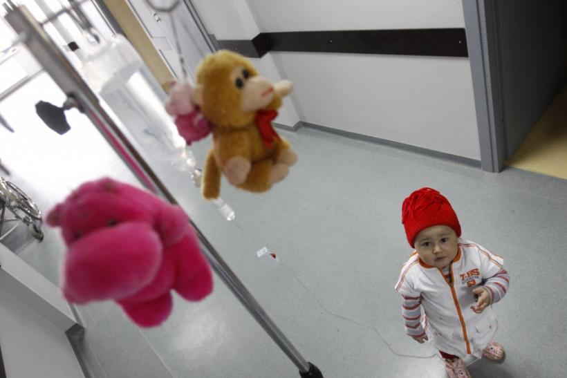 Mari, a 3 year-old leukaemia patient, stands next to her IV drip at the corridor of onco-hematology department of the Iashvili Central Children's Hospital
