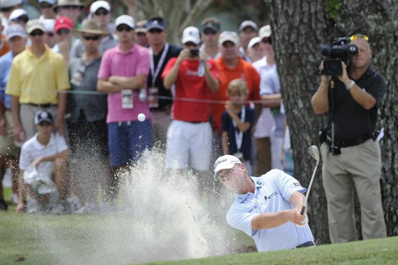 Steve Stricker of the U.S. hits from a bunker to the fifth green during the first round of the 93rd PGA Championship golf tournament at the Atlanta Athletic Club in Johns Creek
