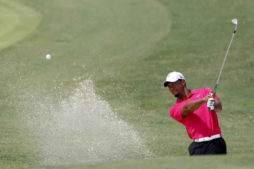 Tiger Woods of the U.S. hits from a bunker on the first hole during the first round of the 93rd PGA Championship golf tournament at the Atlanta Athletic Club in Johns Creek