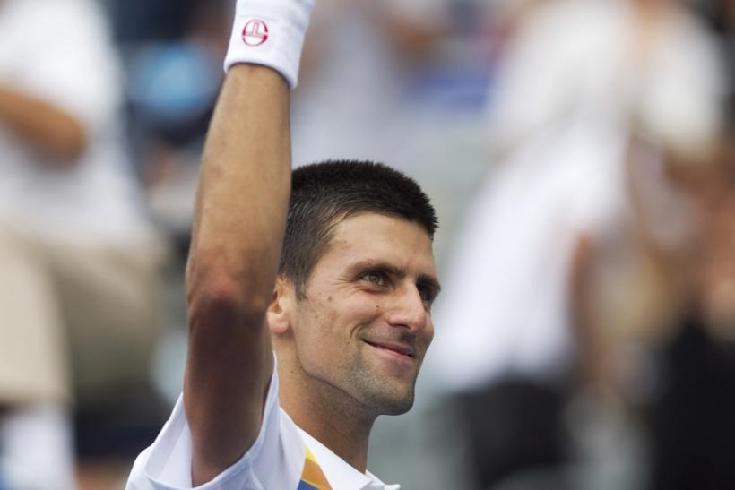 Serbia's Djokovic celebrates win over Russia's Davydenko at the Rogers Cup tennis tournament in Montreal