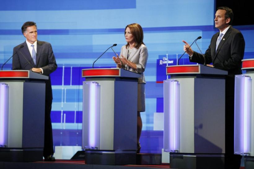 U.S. Republican presidential candidates Mitt Romney, Michele Bachmann and Tim Pawlenty attend the Republican presidential debate in Ames