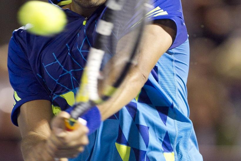 France's Tsonga hits a return to Switzerland's Federer at the Rogers Cup tennis tournament in Montreal