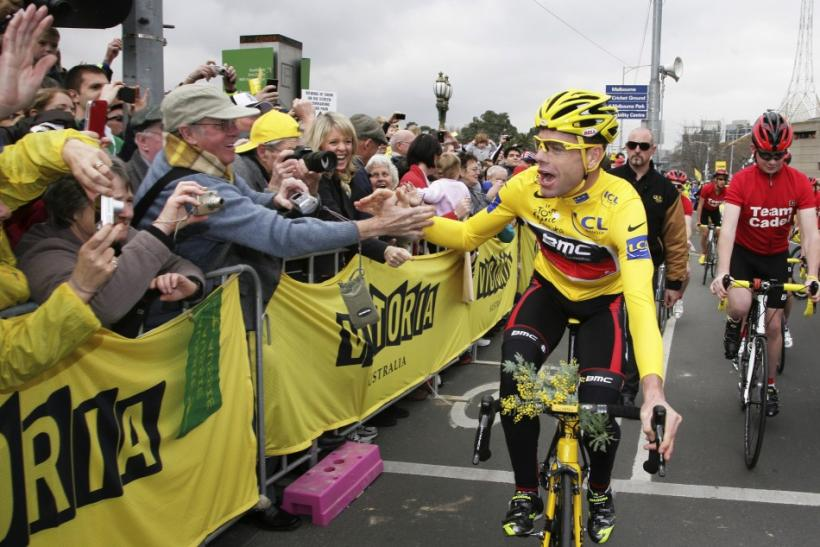 Tour de France winner Evans is congratulated by fans as he rides through the streets of Melbourne during an official homecoming ceremony