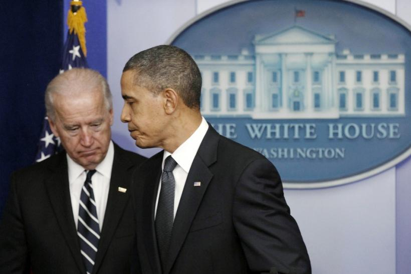President Obama walks off the podium in front of Vice President Biden