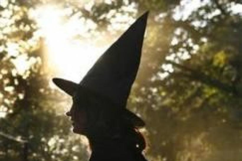 A woman dressed as a witch walks along the street during Halloween celebrations in Port Washington, New York, October 31, 2007.