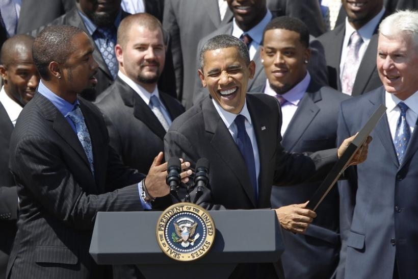 U.S. President Obama laughs with Charles Woodson as he honours the Green Bay Packers at the White House in Washington