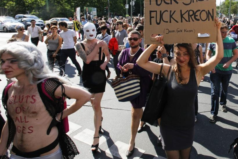 A woman holds a banner during a SlutWalk rally in central Berlin