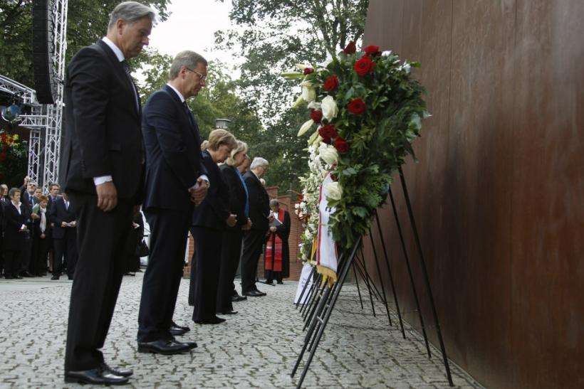 Berlin Mayor Wowereit, German President Wulff, Chancellor Merkel and State Premier Kraft attend wreath laying ceremony marking the 50th anniversary of the building of the Berlin Wall in Berlin