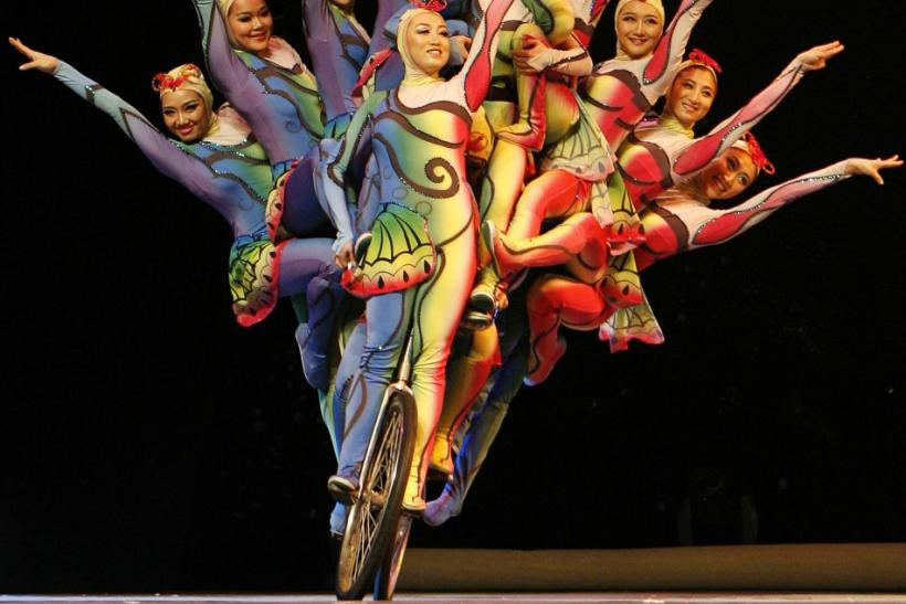 "Chinese performers ride on a bicycle during the ""Grand China National Acrobatic Circus Splendide!"" at Araneta Coliseum in Quezon City Metro Manila"