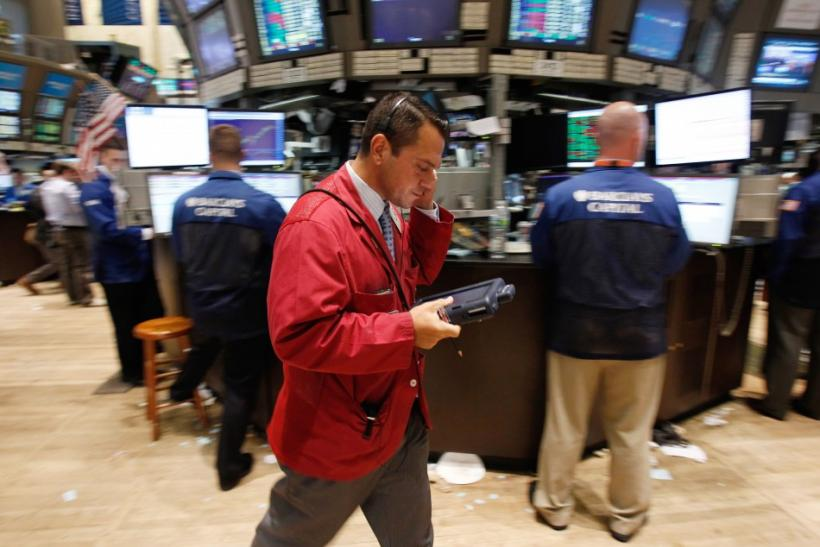 A trader works on the floor of the New York Stock Exchange in New York