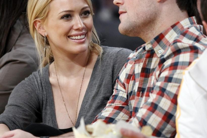 Actress Duff and her fiance, pro hockey player Comrie, sit court side during the NBA Western Conference final playoff series between the Los Angeles Lakers and the Phoenix Suns in Los Angeles
