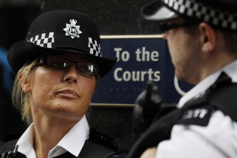 Two police officers stand outside Westminster Magistrates Court in London