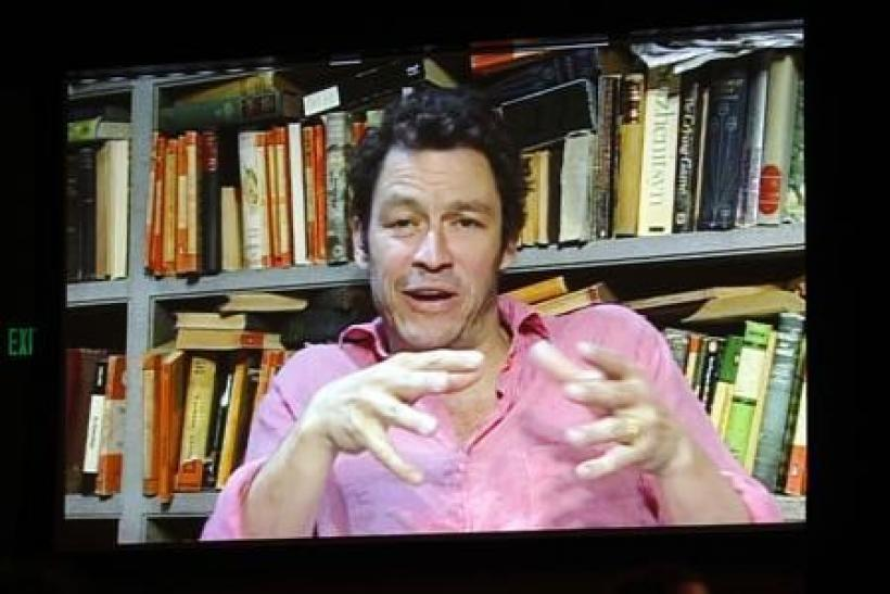 """Actor Dominic West, shown on a video screen via satellite from London, takes part in a panel discussion about the BBC America series """"The Hour"""", in which he is acting, during the 2011 Summer Television Critics Association Cable Press Tour in Bev"""
