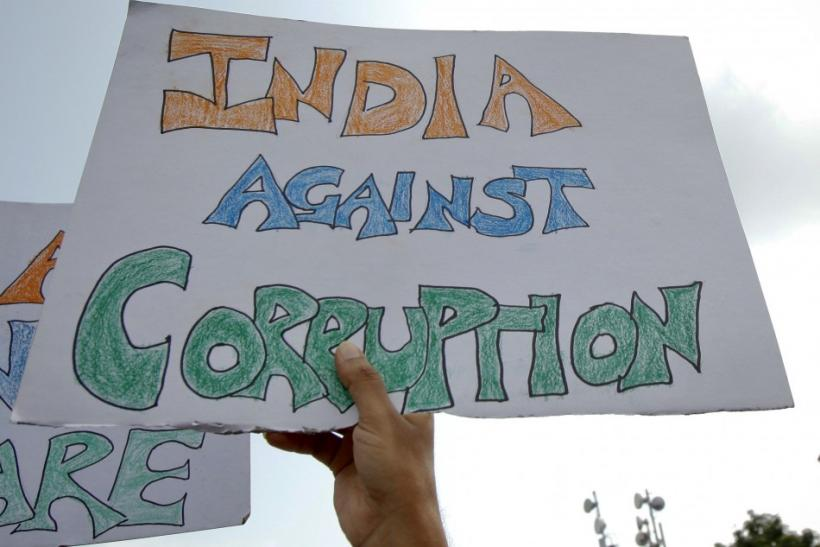 Supporters of Anna Hazare wave placards during a protest rally against corruption in Mumbai