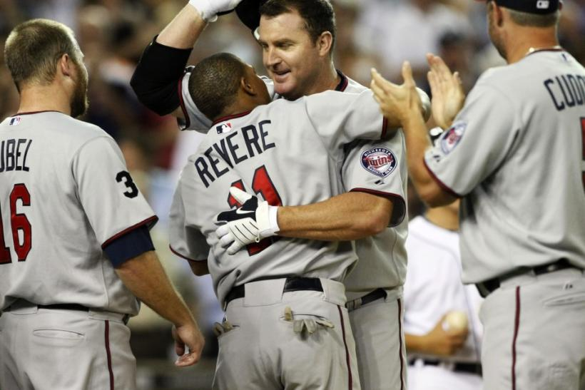 Minnesota Twins' Thome celebrates at home-plate with his teammates after hitting his 600th career home-run during their MLB American League baseball game against the Detroit Tigers in Detroit