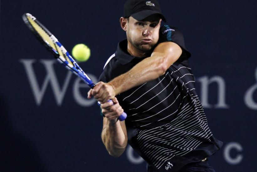 Roddick of the U.S. hits a return to Kohlschreiber of Germany during their first round match of the Cincinnati Open tennis tournament in Cincinnati