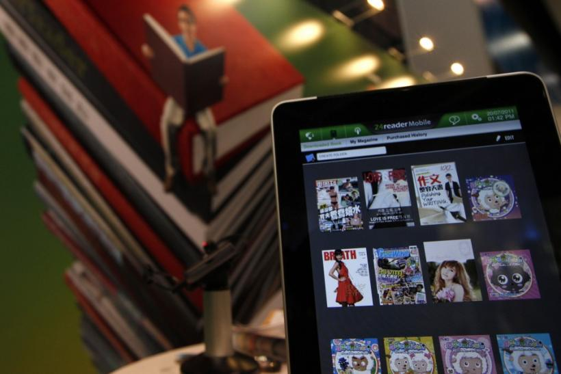 An Apple iPad 2 is pictured showing a library through a software application at the Hong Kong Book Fair
