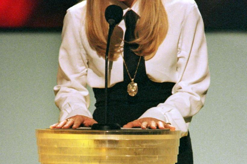 Singer Madonna speaks to the audience at the 1997 MTV Video Music Awards at New York's Radio City Music Hall September 4 where she introduced a performance by the group Prodigy. A somber Madonna used the opportunity to speak of the tragic death of Diana P