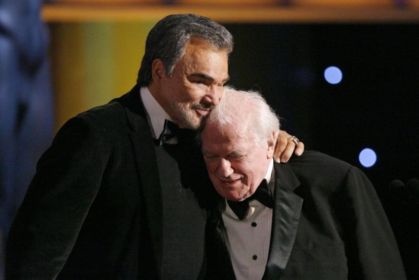 Actor Burt Reynolds hugs Charles Durning after he accepted the Lifetime Achievement award at the 14th annual Screen Actors Guild Awards in Los Angeles