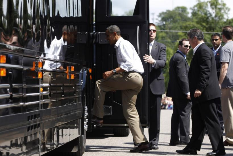 U.S. President Obama steps aboard his bus in Cannon Falls