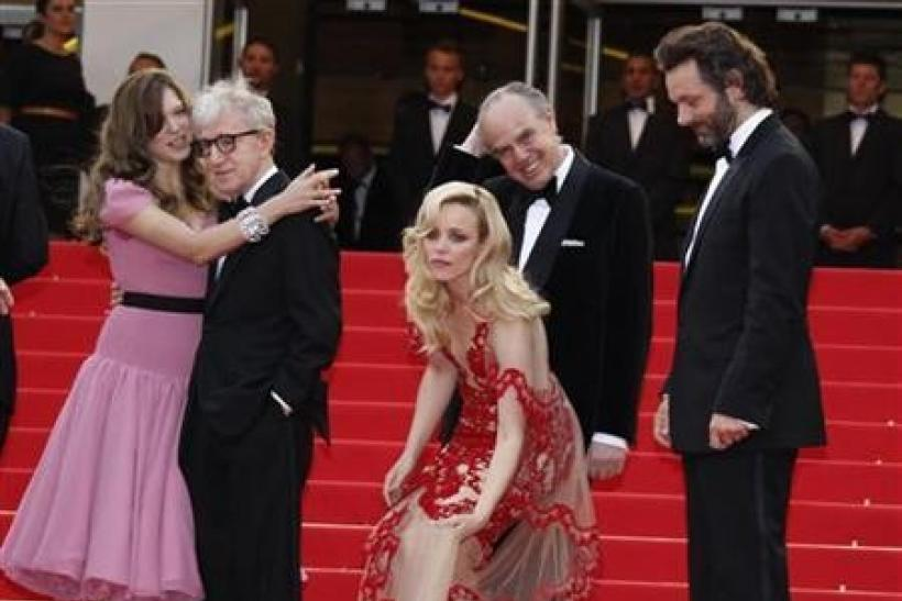 Director Woody Allen (2nd L) arrives with cast members Lea Seydoux (L), Rachel McAdams (C) and Michael Sheen (R) for the screening of ''Midnight In Paris'' and for the opening ceremony of the 64th Cannes Film Festival in Cannes