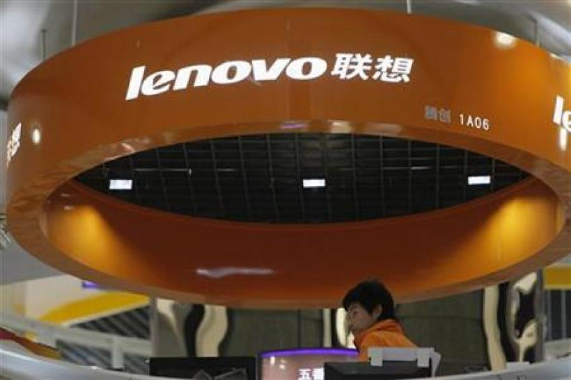 A salesperson waits for customers at a Lenovo shop in Shanghai