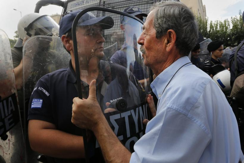 Retirees battled riot police in a protest in Athens Monday, a day before German chancellor Angela Merkel was set to land in the city.
