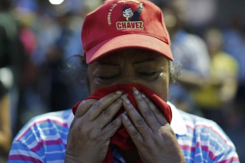 A supporter of Chavez mourns