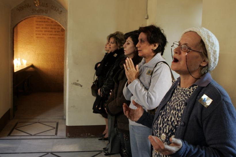 Syrian Armenians attend the Christmas Day Mass at Airmen Orthodox church in Damascus,