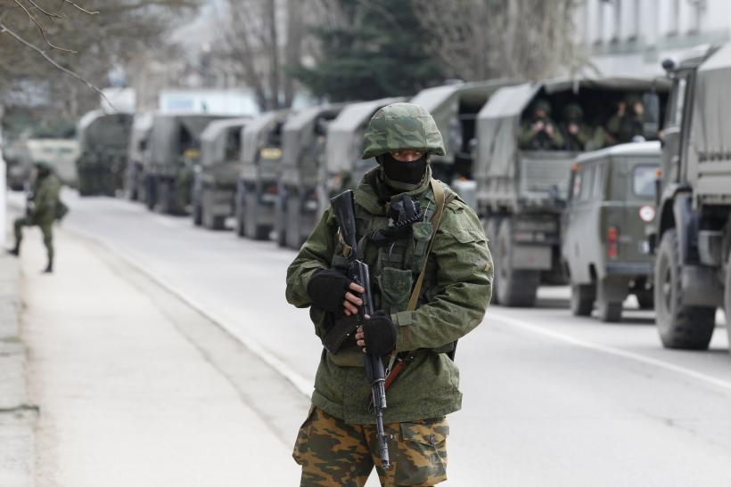 Armed servicemen outside Ukraine border guard post