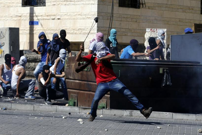 Palestinian youth rock thrower