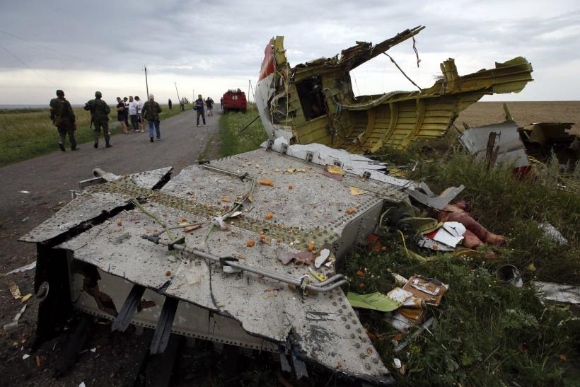 2014-07-17T181921Z_2062382905_GM1EA7I06BM01_RTRMADP_3_UKRAINE-CRISIS-AIRPLANE-TOLL