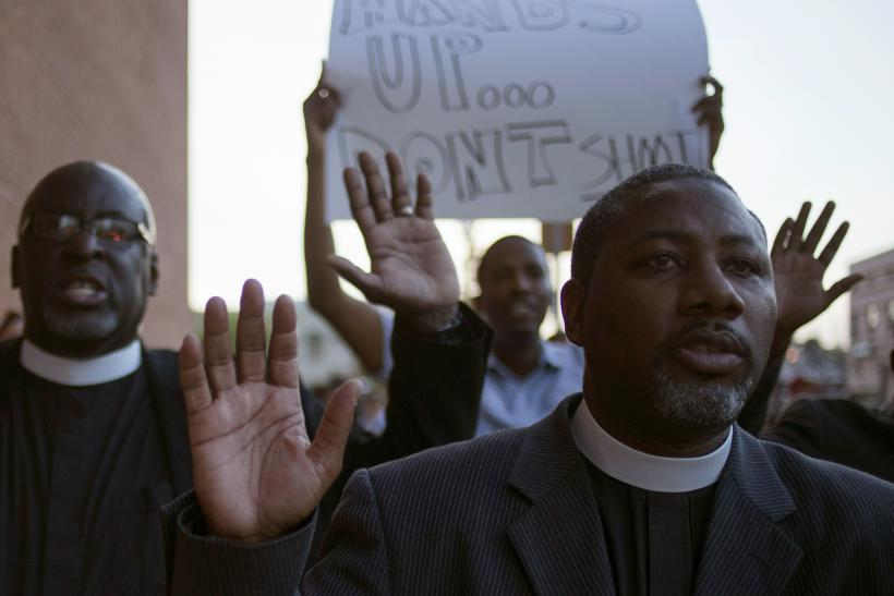 clergymen march to the County Prosecutor Bob McCulloch's office