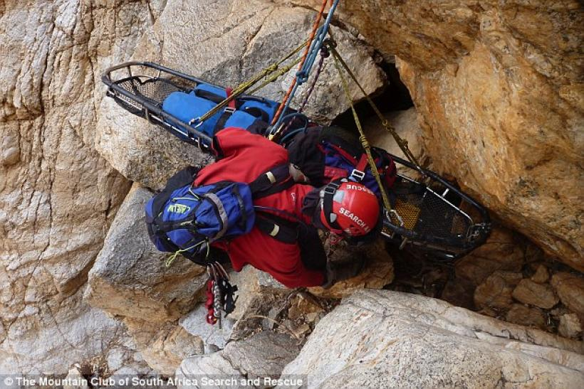 rescue-worker-lowers-stretcher-help-tsenolo-shadrack-rasello-whose-leg-had-be-amputated-after
