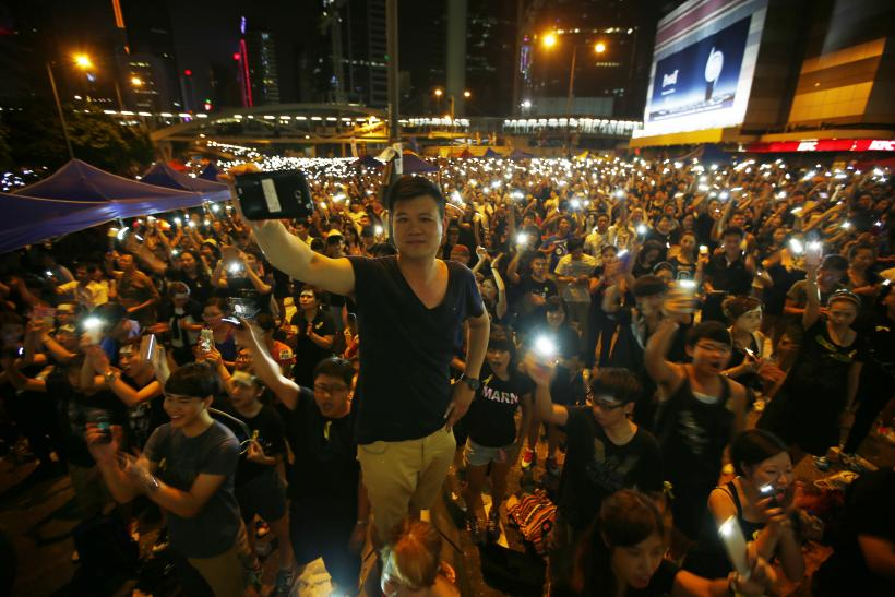 Hong Kong protesters hold mobile devices
