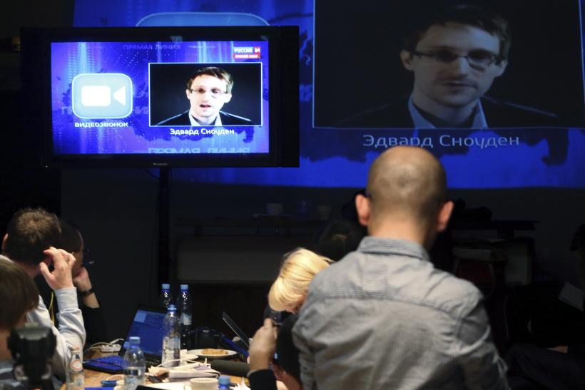 journalists listen to Snowden