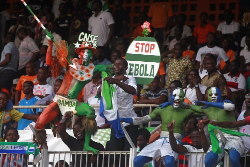 Ivory Coast Supporter Holds Up A Sign About Ebola