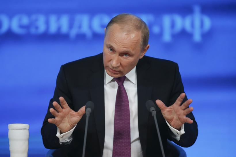 2014-12-18T113058Z_77154755_GM1EACI1I4Y01_RTRMADP_3_RUSSIA-CRISIS-PUTIN-SUPPORT