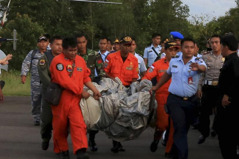AirAsia personnel carrying possible debri