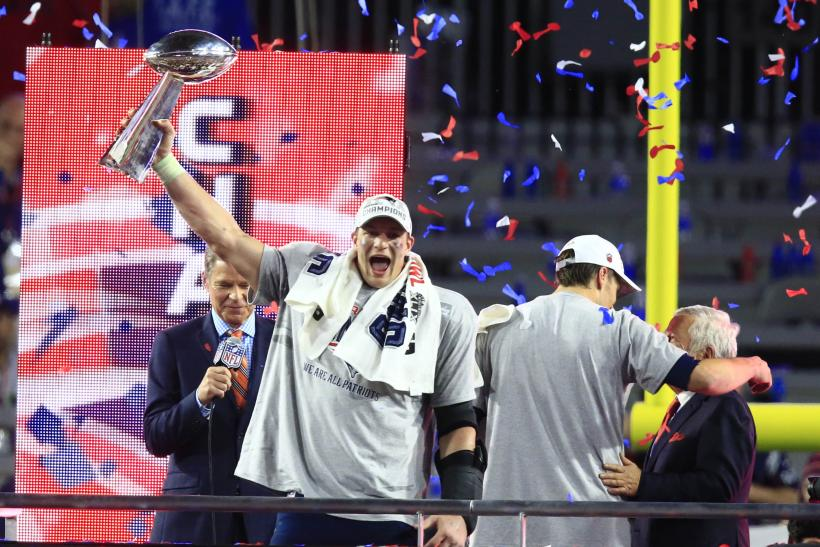 [11:55] New England Patriots tight end Rob Gronkowski holds the Vince Lombardi Trophy after defeating the Seattle Seahawks 28-24 in Super Bowl XLIX