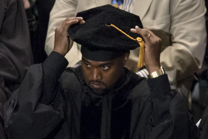 [13:13] Musician Kanye West adjusts his cap before receiving an honorary doctorate degree from School of the Art Institute of Chicago