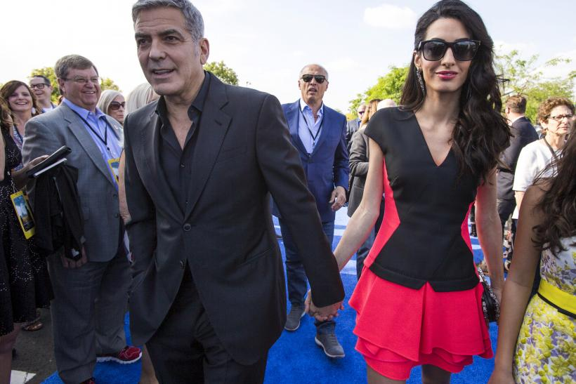 "[9:01] Cast member George Clooney arrives with his wife Amal at the premiere of ""Tomorrowland"" at AMC theatres"